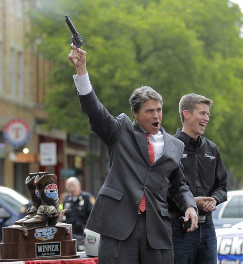 Perry shoots gun